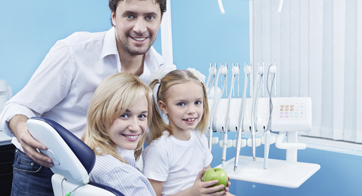 Couple with daughter in dental office