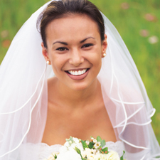 Smiling woman in wedding dress