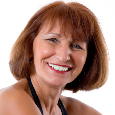 Woman smiling to show white teeth